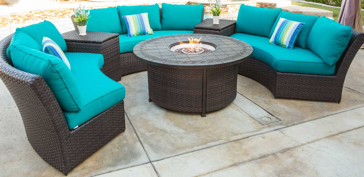 Outdoor wicker woven circular sofa set with teal cushions